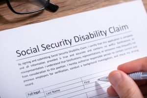 Person Filling Social Security Disability Claim - social security professionals - law office donald h peters michigan